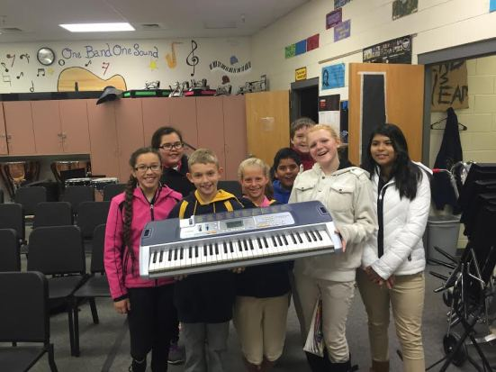 Image of students holding up a keyboard.