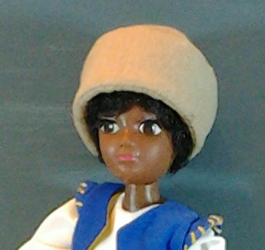 Image of Hasbro World of Love Soul doll wearing hand-made, flannel hat