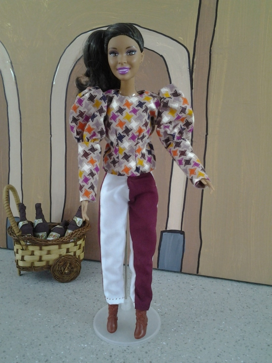 Image of a Barbie doll wearing a harlequin-style costume
