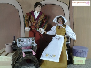 Image of Ken doll dressed as prince and Barbie doll dressed as a lady in waiting. Patterns available from ChellyWood.com