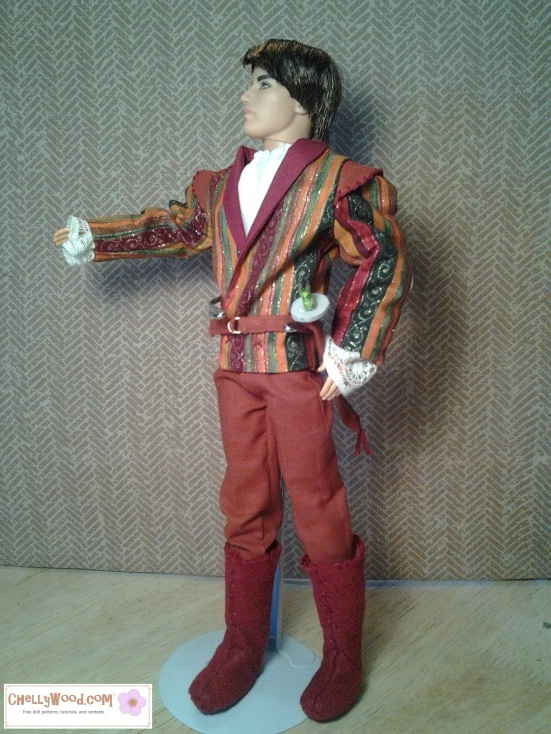 Image of Ken (Ryan) doll in a prince costume with fancy jacket, trousers, boots, sword, and sword belt