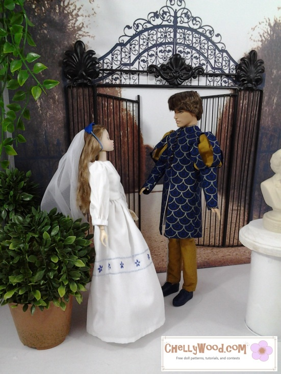 Image of Momoko doll dressed in white standing next to Ryan doll (Ken) dressed in Navy and gold Renaissance tunic.
