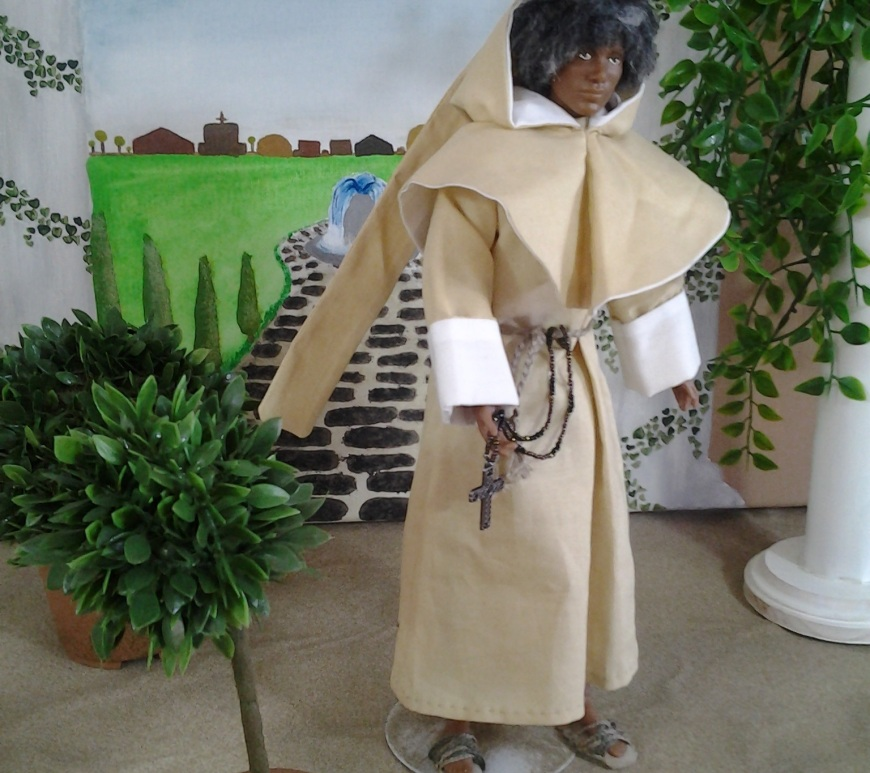 Image of African American Ken doll dressed as Friar Laurence from Shakespeare's Romeo and Juliet