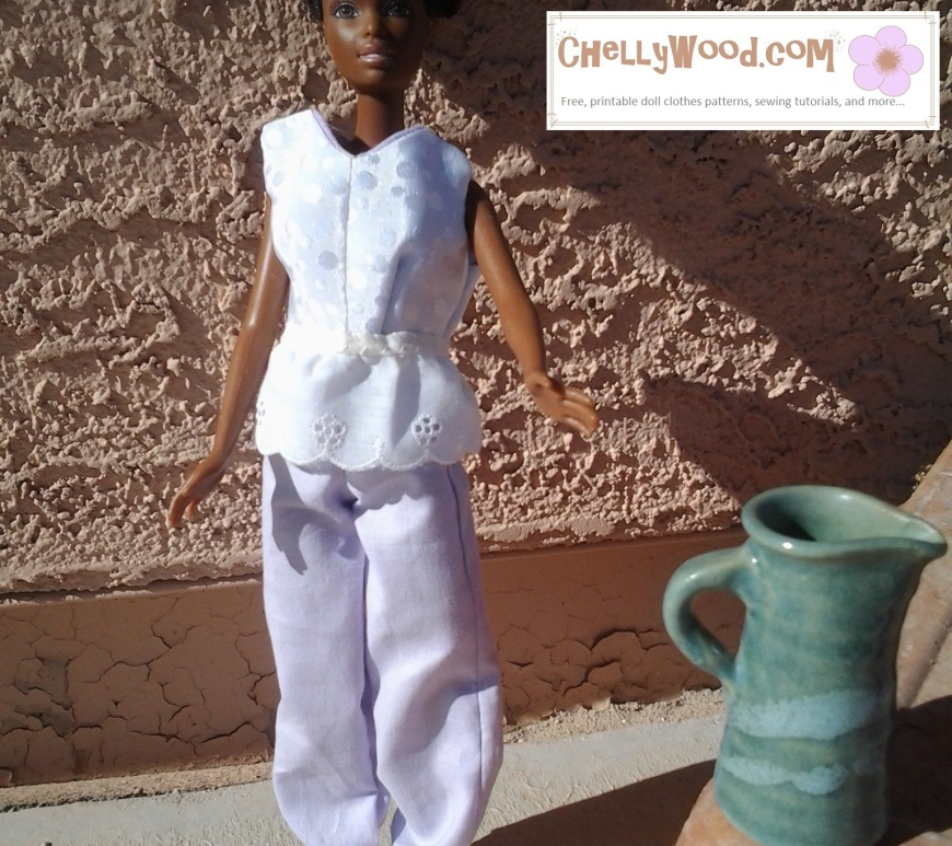 Image of African Barbie in Lebanese sherwal-style pants and white top standing in a desert-like diorama with a green ceramic water jug.