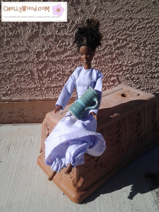 Image of Black Barbie seated in a Middle-Eastern diorama. She holds a pottery-style pitcher and wears traditional Lebanese clothing or Arabic-looking costume.