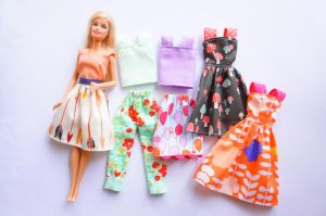 Image of modern Barbie doll wearing handmade doll clothing sewn by AllySews Etsy business person.
