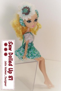 Image of BJD (ball-jointed doll) in white blouse with green overall-style skirt