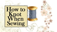 """This image shows a spool of thread with a needle stuck in it. The overlay says, """"How to knot when sewing"""" and the background shows silver swirls with pink flowers and tan leaves. This is the header for a video tutorial showing people how to make a knot with a needle and thread when you're sewing by hand or doing embroidery. This tutorial video can be found at ChellyWood.com."""