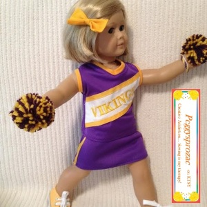 Image of Minnesota Vikings cheerleader uniform worn by athletically posed American Girl doll