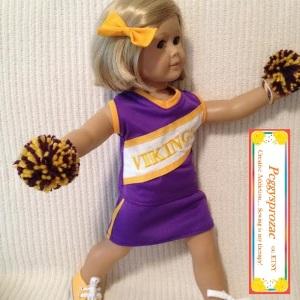Image of Minnesota Vikings cheerleader uniform worn by athletically posed American Girl doll