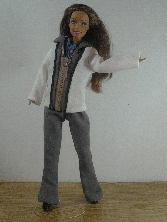 """Image of """"Teresa"""" doll from Mattel wearing hand-made zip-front jacket with handmade boot-cut trousers/pants. The doll appears to be waving at the camera."""
