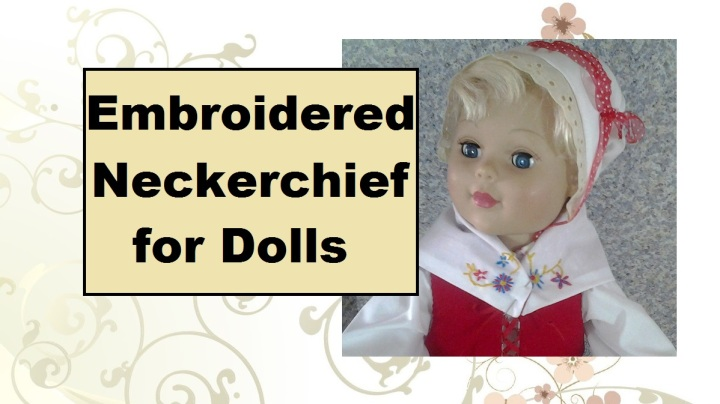 """Image of eighteen-inch doll wearing a folksy-looking neckerchief that has been embroidered with flowers. Header says, """"Embroidered neckerchief for dolls."""""""
