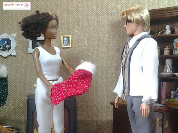 Image of Barbie doll giving Ken doll a Christmas stocking with candy canes inside it.