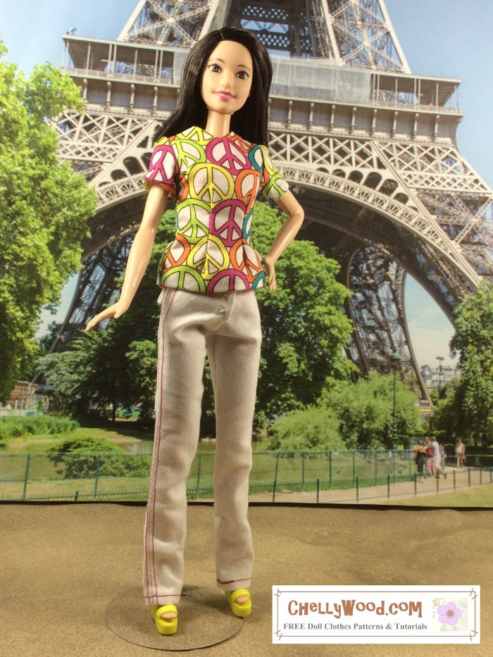 """Image of Mattel's """"Tall Barbie"""" standing in front of the Eiffel Tower in Paris, wearing a pair of white handmade pants with red seams. Barbie has one hand on her hip and the other at her side. She smiles brightly. She's also wearing a princess-seams shirt decorated with peace signs.  Tall Barbie's features look Asian, and her skin tone is pale. The image includes a watermark that says, """"ChellyWood.com"""" for free printable sewing patterns and tutorials."""