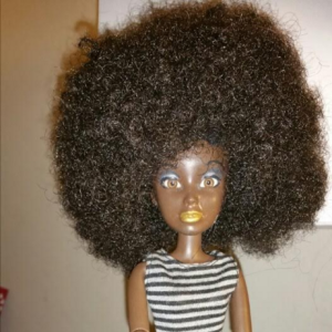Image of African American Liv Doll from Spin Master with repainted skin and a very curly Afro.