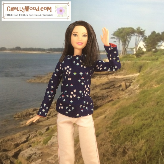 """Image of Mattel's Tall Barbie (trademark) waving to the camera from a beach at Normandy. She wears a hand-made pair of white denim trousers and a long-sleeved floral top. Overlay says, """"ChellyWood.com: Free sewing patterns and tutorials."""""""