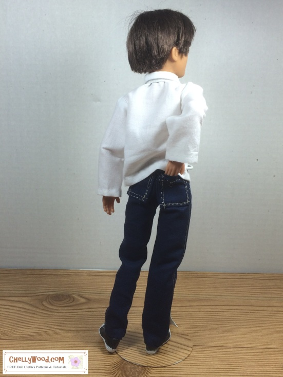 Image of male fashion doll in jeans with large back pockets and white dress shirt. Doll has his back to us, with one hand in his oversized back pocket.