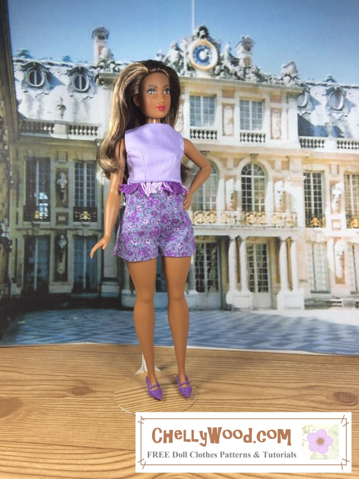 """Image of African American Curvy Barbie from Mattel's Fashionista  line ™ standing in front of the Palace at Verseille in a pair of handmade shorts and a crop top. Overlay says, """"chelly wood dot com: free printable sewing patterns and tutorials for doll clothes"""""""