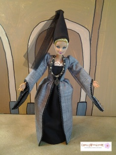 Visit ChellyWood.com for free, printable sewing patterns and tutorials for dolls of many shapes and sizes. This image shows Mattel's Barbie wearing a medieval ball gown and pointed hat with veil in the Romeo and Juliet style.