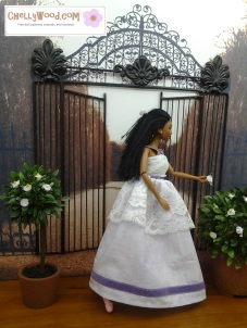 Visit ChellyWood.com for free, printable sewing patterns to fit dolls of many shapes and sizes. Image shows Brandy Norwood doll dressed in a white lacy sundress that would make a good wedding dress or Quinceañera dress for Barbie-sized dolls.