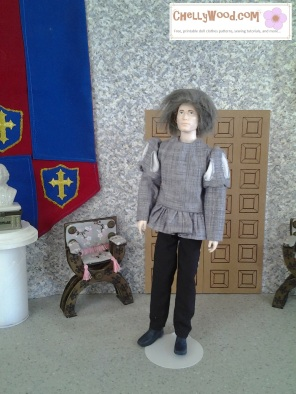 Visit ChellyWood.com for free, printable sewing patterns to fit dolls of many shapes and sizes. Image shows Jackson Rathbone doll (actor who played Jasper in the Twilight movie) dressed in a medieval or Renaissance style tunic and trousers. Pattern for this costume is free at ChellyWood.com, along with a tutorial showing how to make it.
