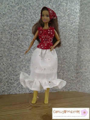 Visit ChellyWood.com for free, printable sewing patterns for dolls of many shapes and sizes. Image shows fashion doll wearing hand-made ruffled eyelet skirt, western-style headscarf, and sleeveless summer top.