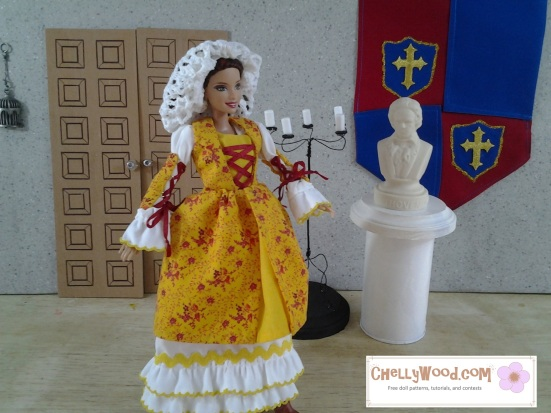 Visit ChellyWood.com for free, printable sewing patterns for dolls of many shapes and sizes. The images shows a fashion doll like Barbie wearing a yellow floral gown with a lace-up bodice, in the style of traditional Basque country costumes. The doll also wears a ruffled petticoat and snood. All patterns and tutorials for sewing this outfit are free and printable at ChellyWood.com