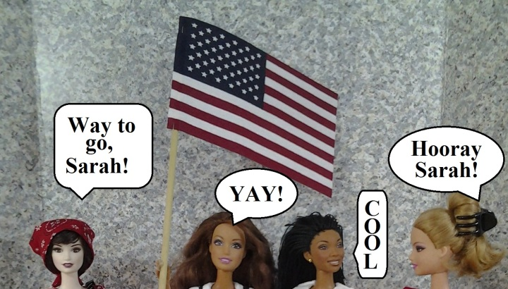 "Visit ChellyWood.com for free, printable sewing patterns and tutorials, as well as contests. Image shows 4 Barbie dolls' heads. One doll holds a United States flag. Each doll has a speaking bubble, like one might see in a comic book. One doll says, ""Way to go, Sarah!"" Another doll says, ""YAY!"" A third doll says ""Cool."" A fourth doll says ""Hooray Sarah!"" These are part of announcement for the winner of a contest for winning a free, home-made Barbie doll dress. For similar contests, visit Chelly Wood dot com."