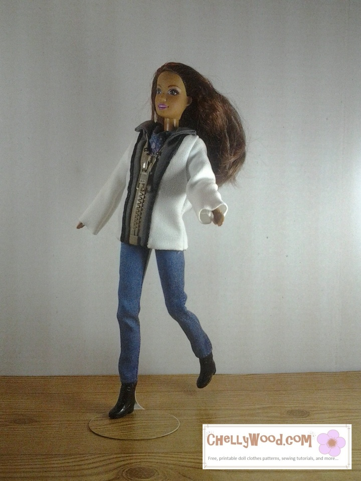 "Visit ChellyWood.com for free, printable sewing patterns for dolls of many shapes and sizes. Images shows Mattel's ""Teresa"" doll running across a wooden floor, wearing a two-toned (charcoal grey and creamy-white) jacket with a zipper that goes up to a collar. She also wears a plain pair of jeans. Patterns for both the zipper jacket and the jeans are free and easy to download and print at Chelly Wood dot com."