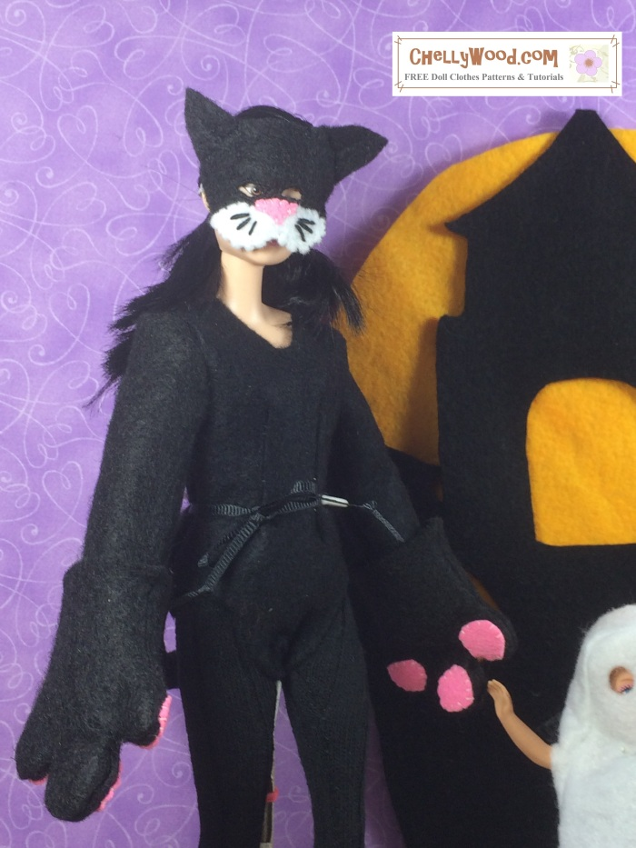 """Image of Made to Move Barbie doll wearing a handmade felt mask and cat bodysuit costume, complete with paws, tail, and tights. Overlay says, """"ChellyWood.com free printable doll clothes patterns and tutorials."""""""