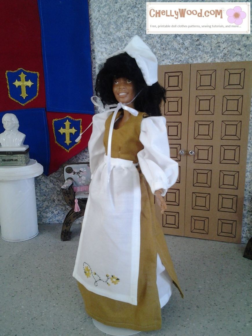 """Image shows African American OOAK Barbie doll wearing a pilgrim's dress with bonnet. The apron she wears is embroidered with tiny daisies and climbing vines. She stands in a diorama with a bust of Shakespeare behind her and double doors, a Renaissance-style chair, and a Renaissance tapestry is up against one wall. Overlay says, """"Chelly Wood dot com: free printable patterns for dolls of many shapes and sizes."""""""