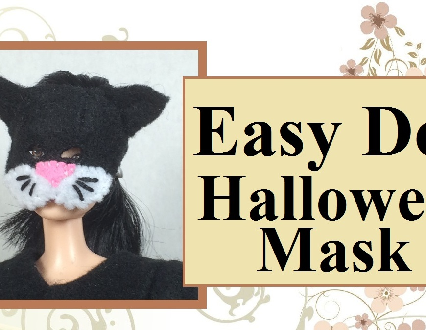 "Image of fashion doll wearing a miniature cat-shaped face mask with eye holes and droopy ears. The mask is made of felt and has a pink nose and whiskers. overlay says ""Easy doll halloween mask."""