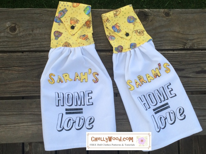 "ChellyWood.com offers free, printable sewing patterns and tutorials. Image shows two tea towels. Their tops are made of yellow kitty-cat fabric, and these tops fold over and button down, so they can easily hang from a handle on a refrigerator or stove. They have applique letters that spell out the name Sarah. The towels themselves say home = love. Altogether, the towels read, ""Sarah's home equals love."""