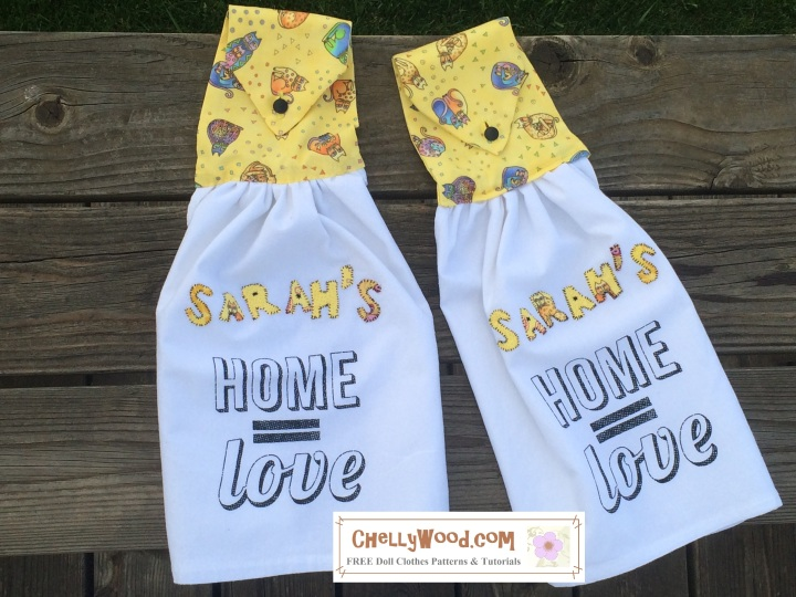 """ChellyWood.com offers free, printable sewing patterns and tutorials. Image shows two tea towels. Their tops are made of yellow kitty-cat fabric, and these tops fold over and button down, so they can easily hang from a handle on a refrigerator or stove. They have applique letters that spell out the name Sarah. The towels themselves say home = love. Altogether, the towels read, """"Sarah's home equals love."""""""