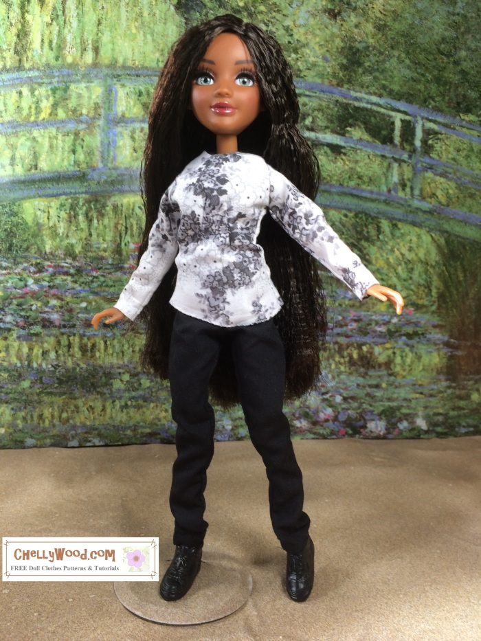 """Image shows the Bryden Bandweth doll from Project MC2 wearing doll clothes especially designed to fit her slender figure. She is posed on a sandy surface with Monet's green bridge from """"Bridge Over a Pond of Water Lilies"""" in the background. The clothes worn by the Bryden Bandweth doll consist of a long-sleeved, grey-and-white floral top over a pair of simple black pants. At the bottom of the image, it says, """"ChellyWood.com: FREE printable sewing patterns and tutorials."""""""