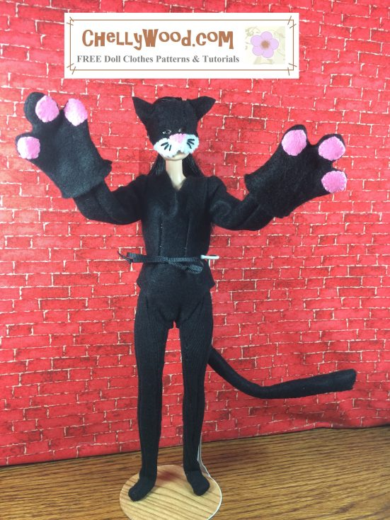 "Image shows a Made-to-Move Barbie® wearing a hand-made cat costume, complete with paw-mittens, tail, felt bodysuit, and felt cat mask. The watermark says ""Chelly Wood dot com FREE printable sewing patterns for dolls of many shapes and sizes."" The doll stands before a brick background, and her paw-mittens are raised like she's ready to attack. her long cat tail is curved like it's swishing in anticipation of an attack. Her mask has little black whiskers and a tiny pink nose. The ears are pointed but very kitten-like."