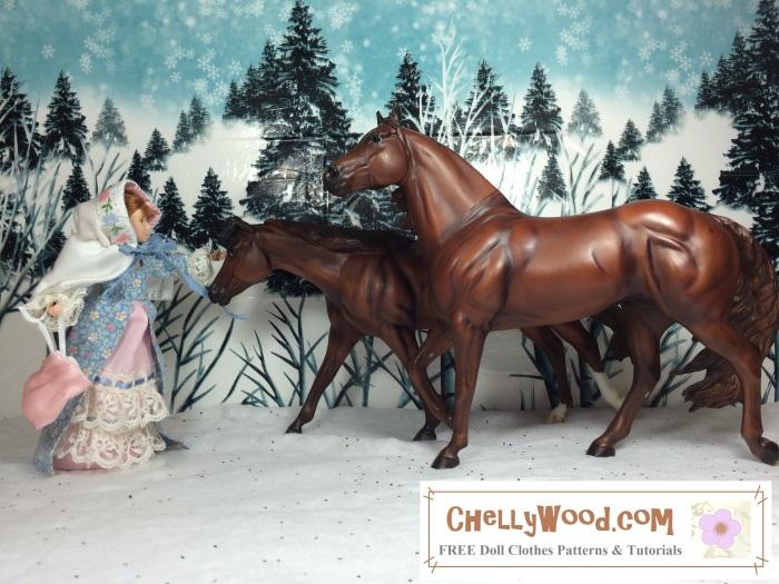 """Image shows Breyer rider doll dressed in a pioneer style winter ensemble with Victorian cape and lacy gown. She shares a snowy forest scene with two Breyer model horses. The watermark at the bottom of the photo says, """"ChellyWood.com, free printable sewing patterns for dolls of many shapes and sizes."""""""