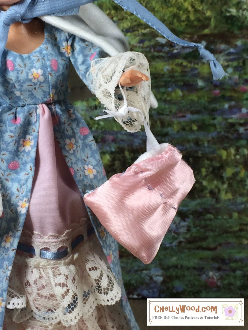 The image shows a small doll wearing a Victorian dress and holding a pink satin purse. The watermark says ChellyWood.com free printable sewing patterns and tutorials for dolls of many shapes and sizes.