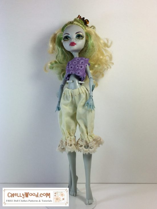 """Image shows Monster High Laguna/Lagoona Blue doll wearing a pair of lacy-bottom bloomers (pantaloons) and a purple crop top. Overlay says, """"ChellyWood.com: free printable sewing patterns for dolls of many shapes and sizes."""""""