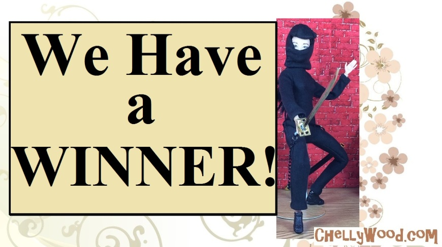 "Image shows a Made-to-Move Barbie (from Mattel) wearing a handmade ninja mask and hand-made ninja body suit. She holds a 1:6 scale samurai sword. The overlay reads, ""We have a winner"" and the watermark states the following website's URL: ChellyWood.com"