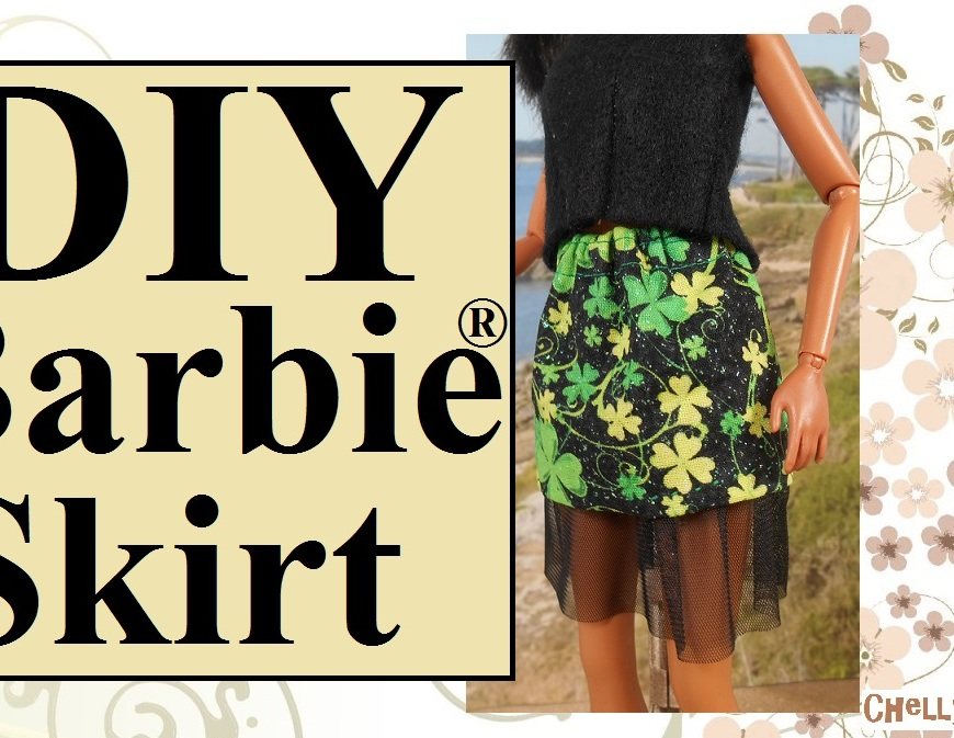 "Image shows African American Barbie wearing a mini skirt with tulle petticoat. The miniskirt fabric is black and glittery, with a shamrock print for St. Patrick's Day. The doll wears a black felt sleeveless shirt. Overlay says, ""DIY Barbie skirt"" and the watermark says ""ChellyWood.com."""