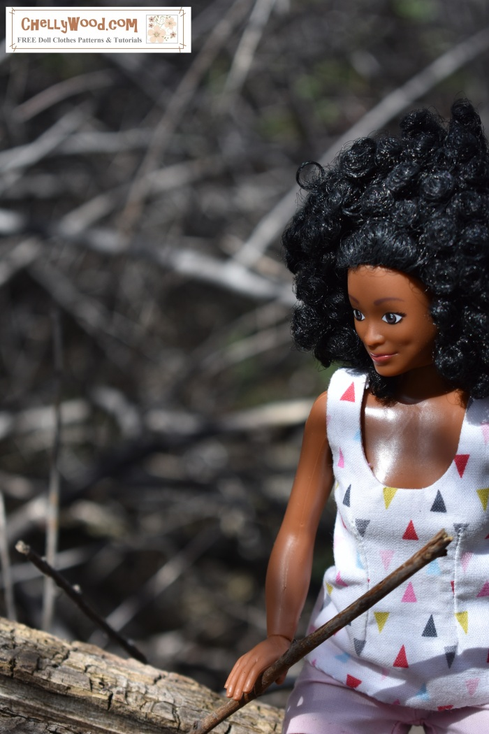 """Lammily.com's """"Photographer"""" doll is seen posing for pictures in a magical forest landscape."""