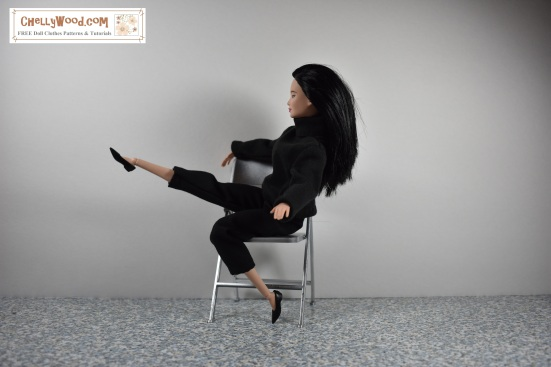 "Image shows a Made-to-Move Barbie from Mattel wearing hand-sewn capri pants and a handmade turtleneck sweater. She is seated on a 1:6 scale folding chair, and she's lifting one leg into the air while balancing herself by holding onto the back of the folding chair. The background is white. Overlay says, ""ChellyWood.com: free printable sewing patterns and tutorials."""