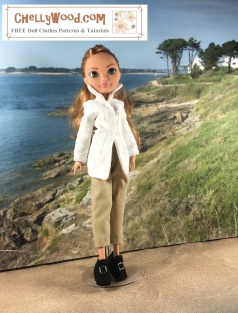 "Visit ChellyWood.com for free, printable sewing patterns for dolls of many shapes and sizes. Image shows an Ashlynn Ella doll from the Ever After High Dolls (EAH Doll) collection. She wears a handmade white blouse which is very elegant with a high collar, a pair of khaki trousers that are short like capris, and a pair of felt handmade shoes. Overlay says, ""ChellyWood.com: FREE Printable sewing patterns for dolls of many shapes and sizes."