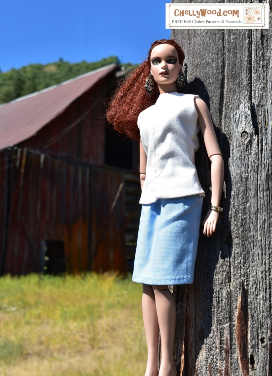 Please visit ChellyWood.com for free, printable sewing patterns for dolls of many shapes and sizes. Image shows the 16 inch Tonner doll wearing handmade doll clothes, including a simple white sleeveless blouse and business-like skirt. She leans against a fencepost with a pastoral scene including a field, barn, and tree-covered mountain in the background. The doll's hair is kinky and auburn-colored, which reminds the viewer of the rusty-color of the barn behind her. The sky is a rich shade of blue. Overlay says: ChellyWood.com: FREE printable sewing patterns and tutorials.