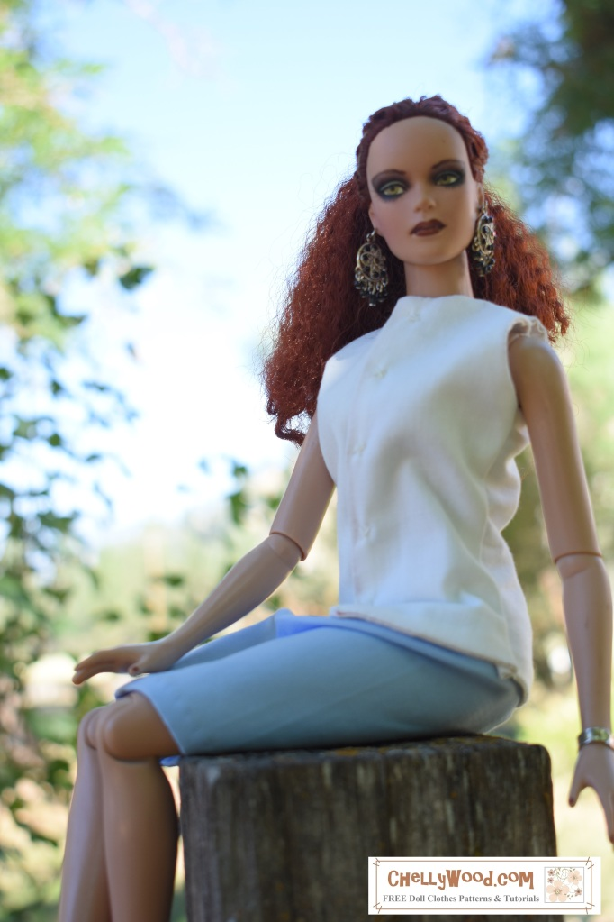 "Image shows Tonner fashion doll seated on a stump, wearing a dressy business-style skirt with summer blouse. Watermark says, ""ChellyWood.com: free printable sewing patterns and tutorials."""