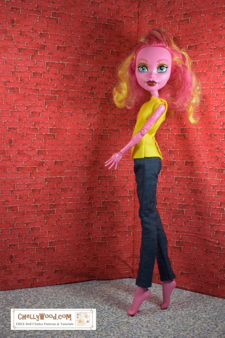 "Image shows the Monster High Doll called ""Gooliope"" from the ""Freak du Chic"" doll collection, wearing a hand-made felt shirt. Overlay offers the website where the free patterns for sewing this shirt can be found: ""ChellyWood.com: free printable sewing patterns and tutorials for dolls of many shapes and sizes."""