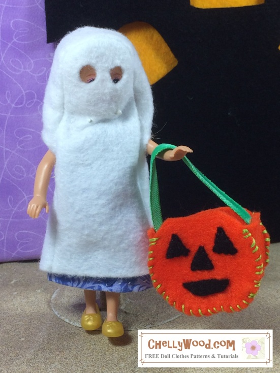 Visit ChellyWood.com for free, printable sewing patterns for dolls of many shapes and sizes. Image shows a Polly Pocket doll wearing a hand-made ghost costume made of felt. She holds a felt jack-o-lantern candy basket. This is a fairly simple sewing project even kids could make, with a little guidance from a parent or guardian.