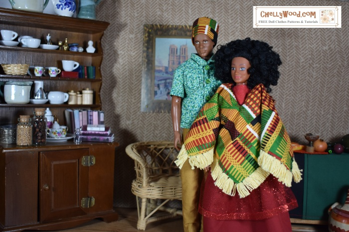 """Image shows Mattel's Ken doll wearing a traditional Kwanzaa hat with a green geometric-patterned shirt and mustard yellow pants. The female fashion doll standing beside him is a """"Photographer"""" doll from the Lammily doll company. She has a curly afro hairstyle, and she wears a hand-made poncho with a colorful African-style print. Her skirt is red with a sparkly overlay of tulle. Behind them, on the wall, is a painting of Notre Dame cathedral in Paris, and the furniture behind them consists of a wicker loveseat and a dark wood china hutch (which houses both elegant pieces of china and a collection of books). The dolls appear to be in close contact, with the male Ken doll placing his arm lightly around the female Lammily doll. Overlay says, """"ChellyWood.com: free printable sewing patterns and tutorials."""""""