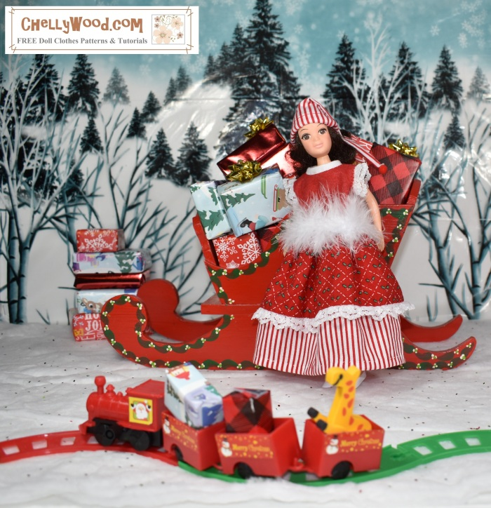 Image shows a Hasbro World of Love doll wearing a hand-made doll dress and elf hat. She stands between a sleigh loaded with wrapped presents and a tiny toy train loaded with gifts and toys. Behind her is a winter-scene diorama, complete with soft snowy hills and trees.